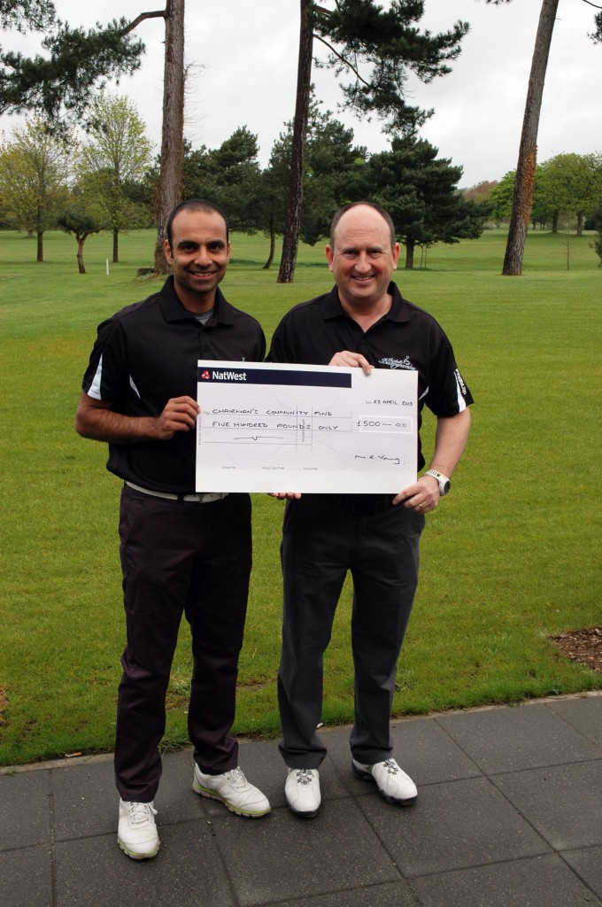 Rishi Sidhu and Peter Golunski with £500 cheque for South Bucks District Council's Chairman's Community Fund. Money raised at the Captain's Day on Saturday 28th March 2015.