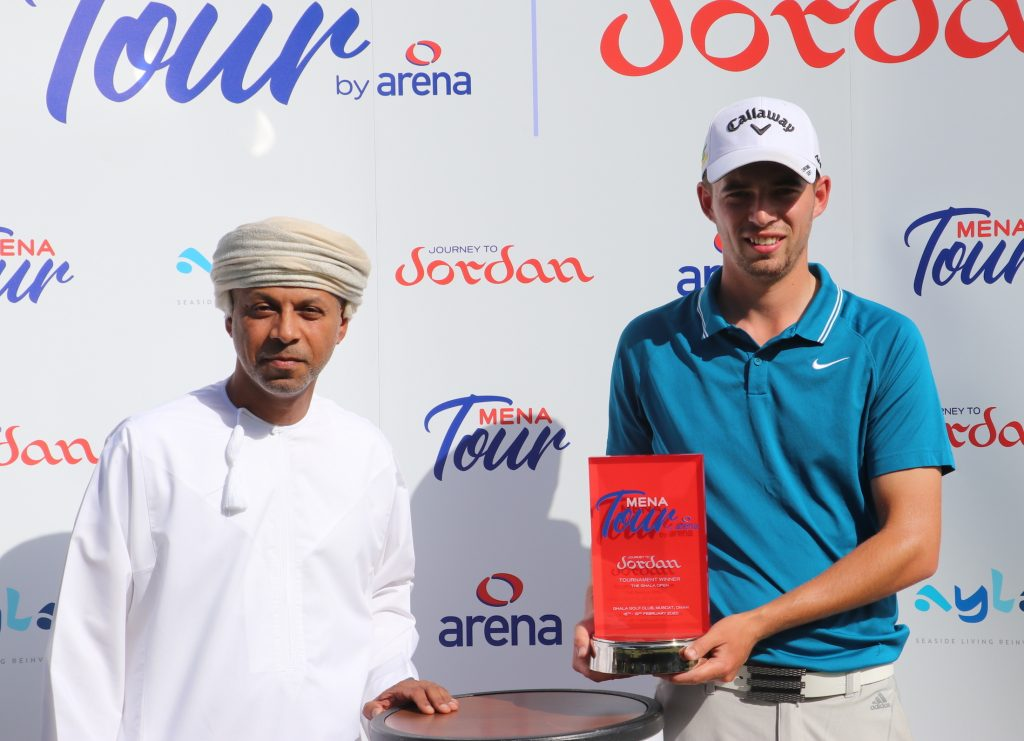Bailey Gill receives his trophy from Ziyad Al Zubair, after winning the MENA Tour's Ghala Open