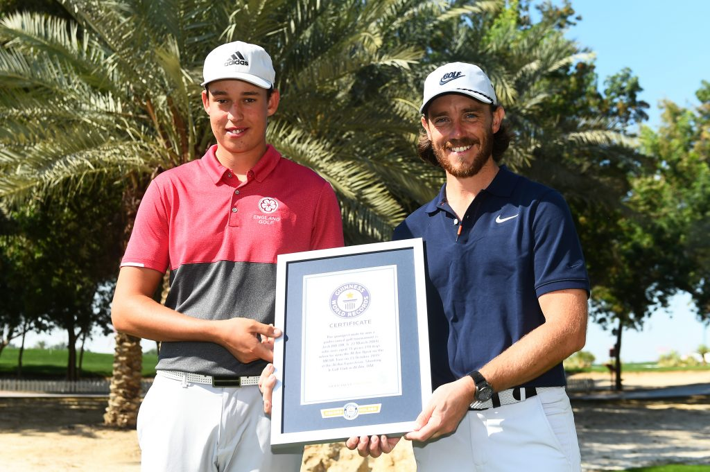 Tommy Fleetwood with Josh Hill, the youngest ever winner of an Official World Golf Ranking tournament at just 15 years old, in October 2020, at the Al Ain Open, on the MENA Tour,