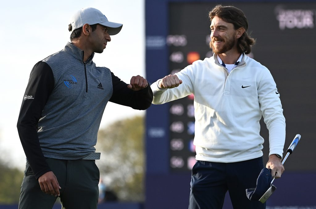 Tommy Fleetwood congratulates Aaron Rai on his first Rolex Series win after a play-off in the 2020 Aberdeen Standard Investments Scottish Open
